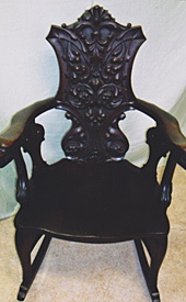 Carved back rocker, after repair by Home Enhancements.
