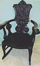 Carved back rocker, before repair by Home Enhancements.