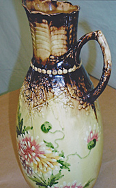 Floral pitcher, after repair by Home Enhancements.