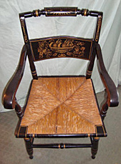 Hitchcock chair, before repair by Home Enhancements.
