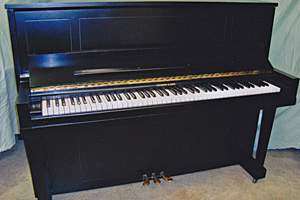 Piano, after restoration by Home Enhancements.