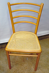 Woven chair seat, after repair by Home Enhancements.