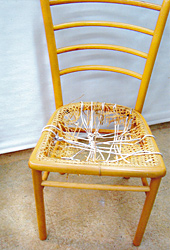 Woven chair seat, before repair by Home Enhancements.